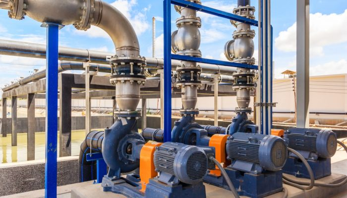Wastewater treatment plant. A new pumping station. Valves and pipes. Urban modern treatment facilities, pipelines and pumps powerful, modern automatic system protection and control